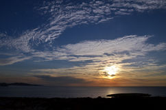 Sunset over the sea. And islands Royalty Free Stock Images