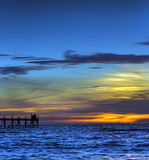 Sunset over the sea with jetty Stock Photos
