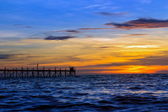 Sunset over the sea with jetty Royalty Free Stock Photos