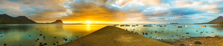 Sunset over sea. Le Morn Brabant on background. Panorama Stock Photo