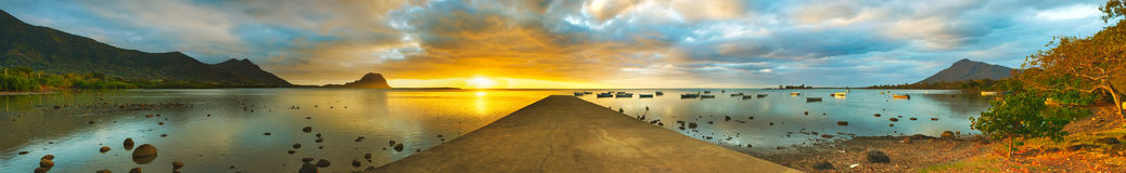 Sunset over sea. Le Morn Brabant on background. Panorama Royalty Free Stock Image