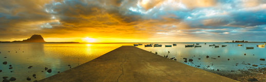 Sunset over sea. Le Morn Brabant on background. Panorama Stock Photos