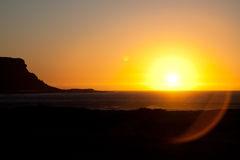 Sunset in Elands Bay. Sunset over the sea with a mountain silhouette. Elands Bay, West coast South Africa Royalty Free Stock Image