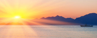 Sunset over sea and mountains Royalty Free Stock Photo