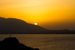 Sunset over sea and mountains Royalty Free Stock Image