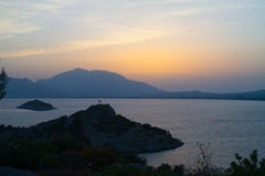Sunset over sea and mountains Stock Photography