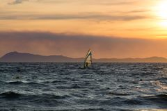 Sunset over the sea or ocean and extreme freestyle sport windsur Royalty Free Stock Image