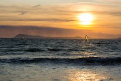 Sunset over the sea or ocean and extreme freestyle sport windsur Stock Photography