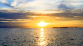 Sunset over sea or ocean with sky and clouds. Sunset over sea or ocean with sky and clouds of Thailand Royalty Free Stock Image