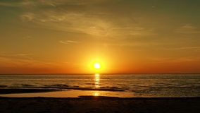 Sunset over sea and orange clouds Stock Photography