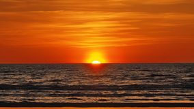 Sunset over sea and orange clouds Stock Photo