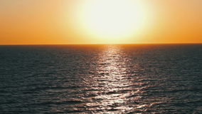 Sunset over the Sea. Sunset orange sun over the surface of the water the sea. Full HD 1920 x 1080, 29,97fps stock video footage