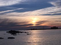 A sunset over the sea in Paphos. SunWt sky over the sea in Paphos Royalty Free Stock Photo