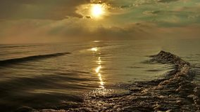 Sun over sea and reflection in water Royalty Free Stock Photo