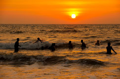 Sunset over the sea and the people. Royalty Free Stock Photos