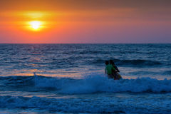 Sunset over the sea and the people. Stock Image