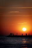 Sunset. Over the sea of people silhouettes stock photos