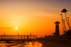 Sunset over the sea. Pier on the foreground. Panorama Stock Photography