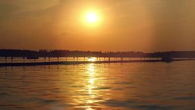 Sunset over the sea. Pier on the foreground in stock video