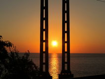Sunset over the sea. Pillars. Royalty Free Stock Photo