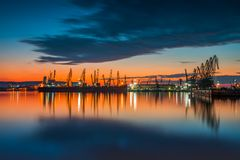 Sunset over sea port and industrial cranes, Varna Stock Photos