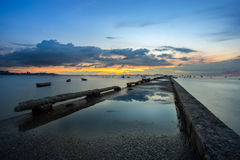 Sunset over the sea and reflection on the pier bridge Royalty Free Stock Photography
