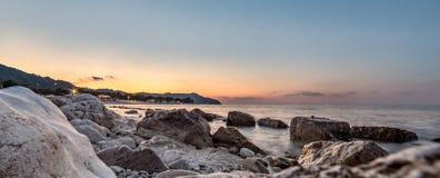 Sunset over sea and rocks. Conero, Italy royalty free stock photos