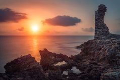 Sunset over the sea and rocky coast Royalty Free Stock Image