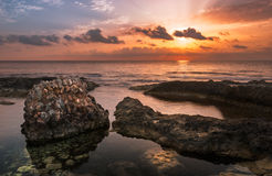 Sunset over the Sea and Rocky Coast with Ancient Ruins Royalty Free Stock Photos