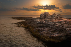 Sunset over the Sea and Rocky Coast Royalty Free Stock Photos