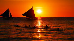 Sunset over the sea. Sailboats cruising at sunset time stock video footage