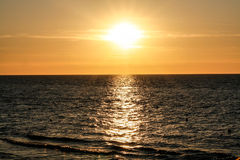Sunset over the sea. The setting sun over Baltic sea Stock Image