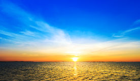 Sunset over sea shore and silhouette shell farm Royalty Free Stock Photos