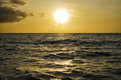 Sunset Over the Sea. A shot of the sun setting over the horizon Royalty Free Stock Image