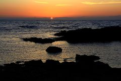 Sunset over the sea with silhouette Royalty Free Stock Photography