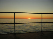Sunset over the sea. The sun quiet sets on the Barcola's horizon Stock Image
