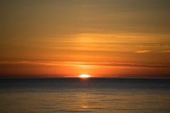 Sunset over the sea. The sun sets in the sea, beautiful sunset Royalty Free Stock Image