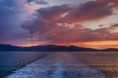 Sunset over the sea. Sun setting over the island of Islay, Scotland Royalty Free Stock Photos