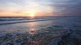 Sunset over the sea, the surf stock video footage