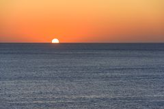 Sunset over sea. Sunset time over Mediterranean sea. Blue and orange main colors of the scene Stock Images