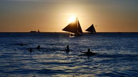 Sunset over the sea in UHD. UHD of sailboats cruising at sunset time stock video footage