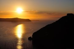 Sunset over the sea. Sunset view from the island of Santorini, Greece, capturing the famous Skaros Rock (on the right) on the island Stock Photography