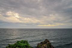 Sunset over the sea. View from Pura Luhur Uluwatu temple, Bali, Indonesia on sunset over the sea Stock Photos