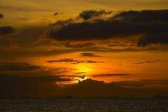 Sunset over the sea water at island Koh Phangan, Thailand Stock Photo
