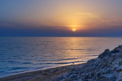 Sunset over the sea on wild beach of Persian gulf coast. Iran. Sunset over the sea on wild beach of Persian gulf coast. Bushehr Province. Iran stock photography