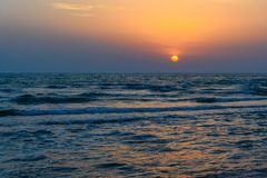 Sunset over the sea on wild beach of Persian gulf coast. Iran. Sunset over the sea on wild beach of Persian gulf coast. Bushehr Province. Iran stock photo