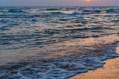 Sunset over the sea on wild beach of Persian gulf coast. Iran. Sunset over the sea on wild beach of Persian gulf coast. Bushehr Province. Iran royalty free stock image