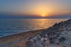 Sunset over the sea on wild beach of Persian gulf coast. Iran. Sunset over the sea on wild beach of Persian gulf coast. Bushehr Province. Iran royalty free stock photo