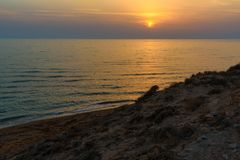 Sunset over the sea on wild beach of Persian gulf coast. Iran. Sunset over the sea on wild beach of Persian gulf coast. Bushehr Province. Iran royalty free stock images