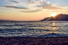 Sunset over the sea. Wonderful sunset on the Punta Rata Beach, Brela, Croatia stock photo
